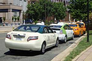 English: Hybrid taxis from several taxi cab co...