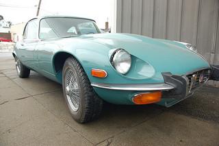 Old Jaguar E-type sports car: front fender